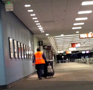 Graveyard crew servicing deserted San Francisco airport gates at two in the morning